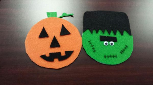 Cut out Halloween Faces of a pumpkin and Frankenstein