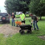 3 men working with shovels and wheelbarrows