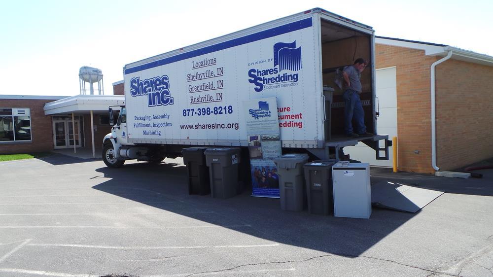 Man standing inside a Shred truck