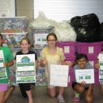 5 children holing up the DCRW Recycling signs