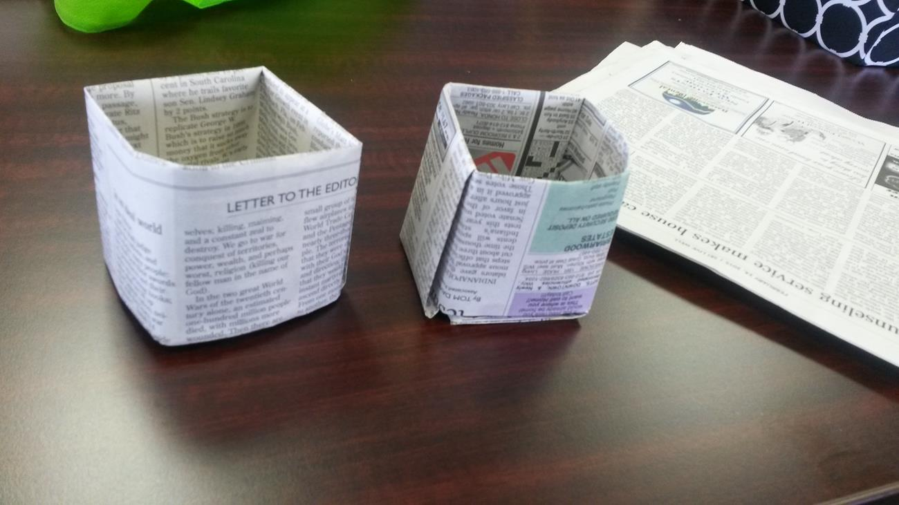 Newspaper planters made with local students