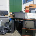 Old TVs and microwaves piled up